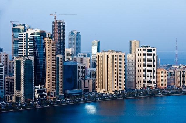 Sharjah city landscape and people. Sharjah, UAE.